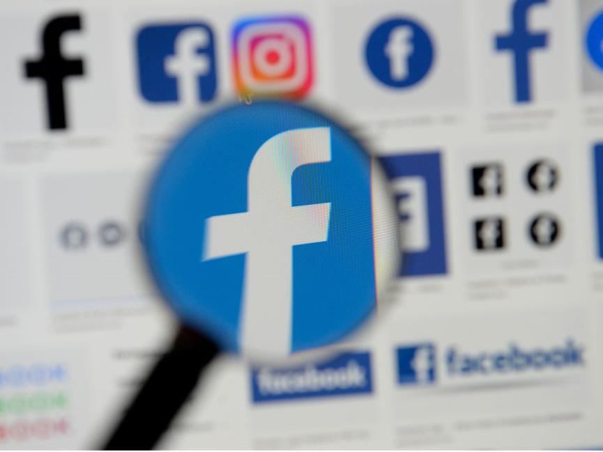Facebook Icon through Magnifying glass
