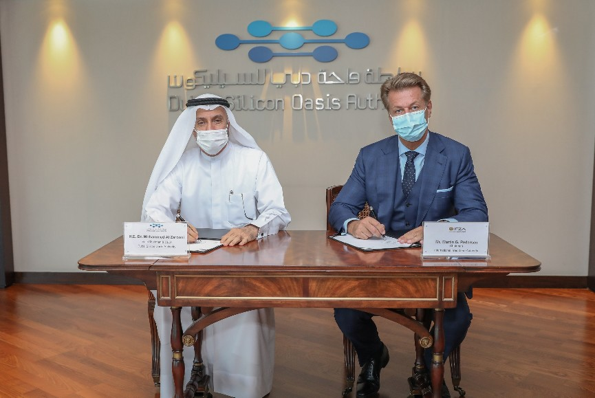 Dr Mohammed Al Zarooni and Martin Signing the Agreement