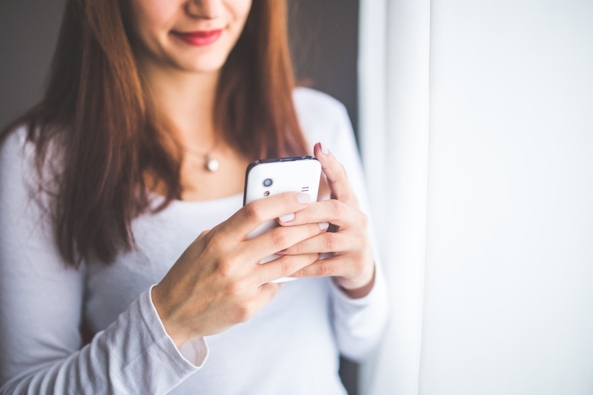 Women Typing on the Phone Image